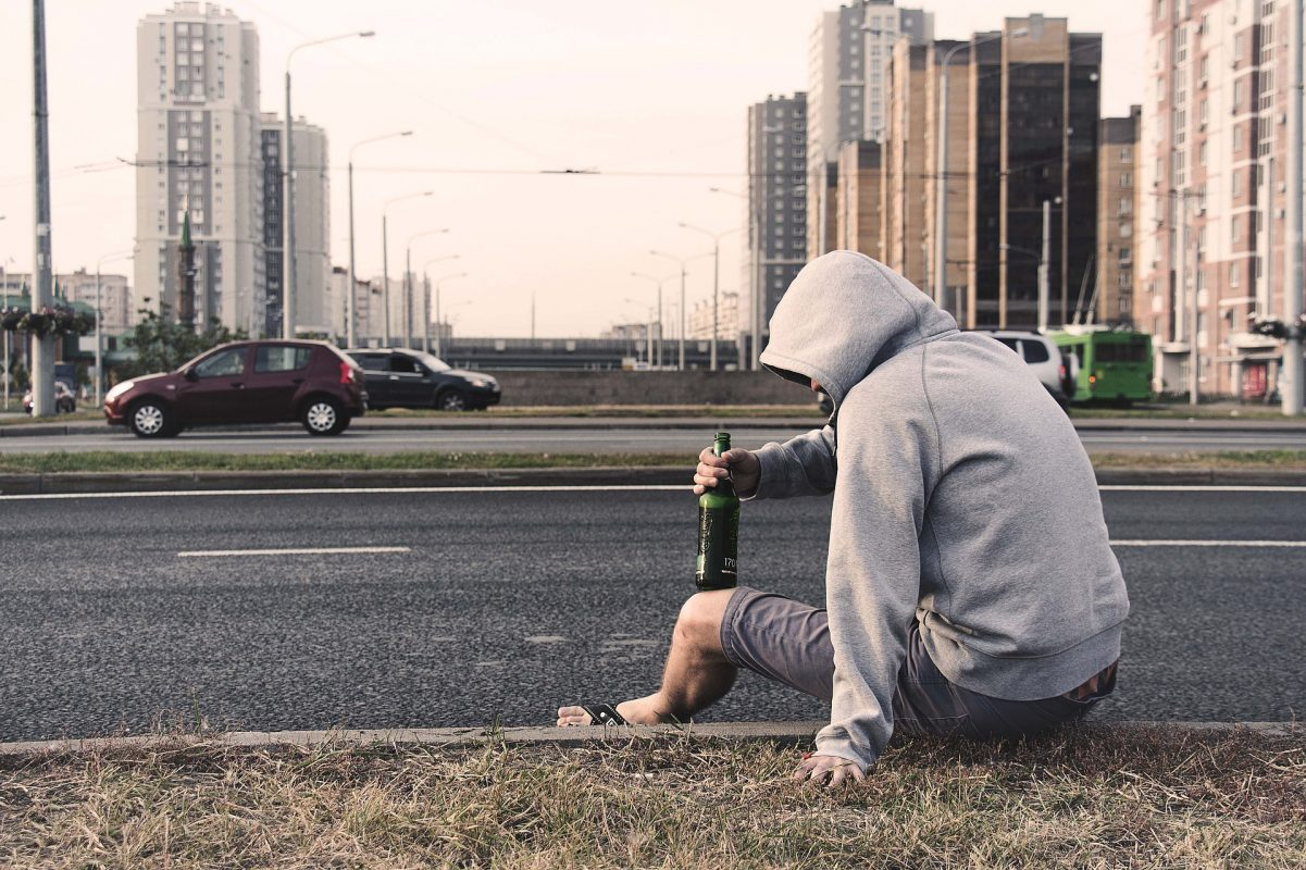 belarusian man sitting on the side of the road