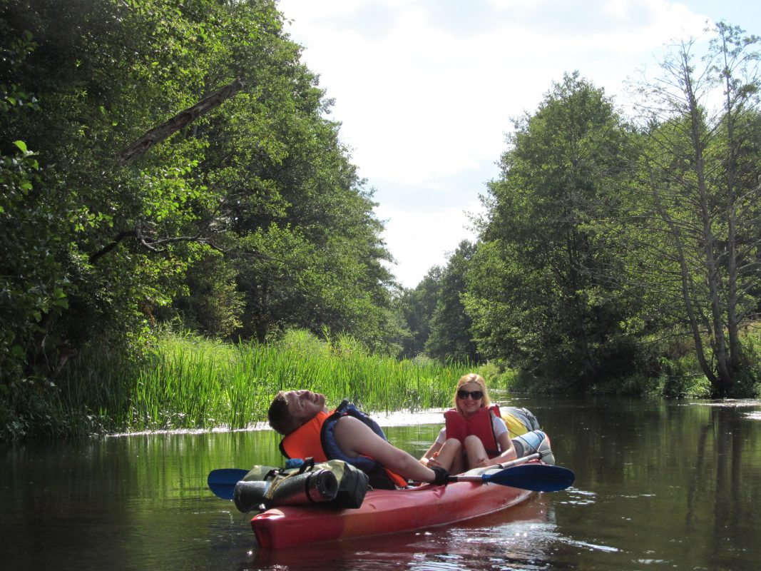 two tourists in a kayak in the river